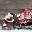 Elks pulling santa sleigh with presents — Stok fotoğraf