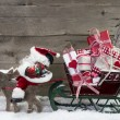 Elks pulling santa sleigh with presents — Photo