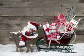 Elks pulling santa sleigh with presents — Foto de Stock