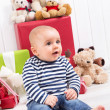 Christmas and birthday - cute baby sitting barefoot and looking  — Foto Stock
