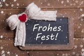 Greeting card for christmas with a red heart and a german text — Stockfoto