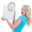 Angry woman with scales — Stock Photo #35379331