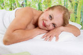 Senior lady at spa — Stockfoto