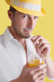 Man drinking orange juice — Stock Photo
