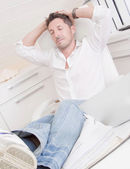 Man relaxing in office — Stock Photo