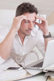 Worried man under pressure — Stockfoto