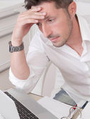 Stressed man in office — Stock Photo