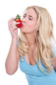Blonde kissing Strawberry — Stock Photo