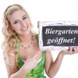 Bavarian woman holding sign — Stock Photo