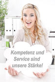 Business lady with signboard — Stock Photo
