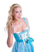 Girl in dirndl thumbs up — Stock Photo