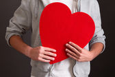 Man holding red heart — Stock Photo