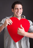 Man with heart thumbs up — Stock Photo