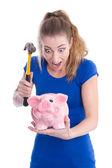 Woman want to break piggy bank — Stock Photo