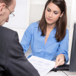 Consulting or business meeting - young businesswoman sales an insurance — Stok fotoğraf