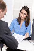 Consulting or business meeting - young businesswoman sales an insurance — Stock Photo