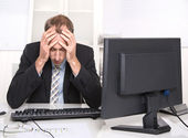 Overworked businessman frustrated and stressed in his office with computer — Stock Photo