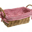 Wicker basket with a white red checkered textile on white background — Stock Photo