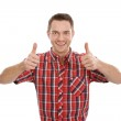 Young man with thumbs up — Stock Photo