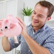 Man holds piggy bank — Stock Photo