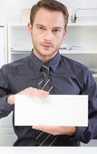 Man with sign in hand — Stock Photo
