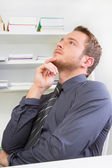 Thoughtful man at work — Stock Photo