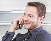 Man flirting on phone — Stock Photo