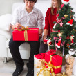 Children under Christmas tree — Stock Photo #35741087
