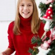Girl with christmas gift — Stockfoto