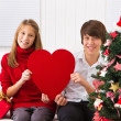 Children with heart on Christmas — Stock Photo #35742043
