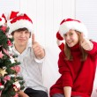Children under Christmas tree — Stockfoto