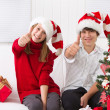 Kids thumbs up on Christmas — Stock Photo