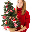 Girl with Christmas tree in hand — Stock Photo