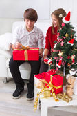 Children under Christmas tree — Stock Photo
