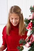 Girl grabs gift — Stock Photo