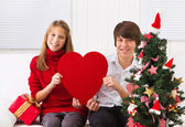 Children with heart on Christmas — Stock Photo