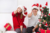 Kids thumbs up on Christmas — Foto de Stock