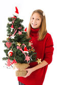 Girl with Christmas tree in hand — Stockfoto