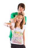 Brother and sister thumbs up and down — Stock Photo