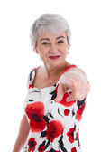 Senior woman pointing with finger — Stock Photo