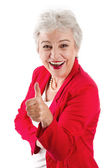 Elderly woman thumbs up — Stockfoto