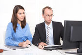 Two business people sitting at desk. — Stock Photo
