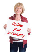 "Senior woman holding billboard with text: ""Update your personality"" — Stockfoto"