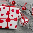 Gift box wrapped in white paper with hearts — Stock Photo #36021499