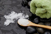 Bath salt on wooden spoon — Stock Photo