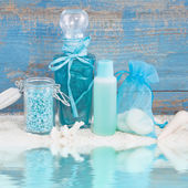 Wellness set in turquoise bottles — Stock Photo