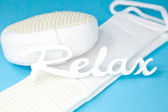 "Word ""relax"" on sponge and scrubber — Stock Photo"