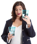 Woman with half-empty water glass — Stockfoto