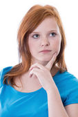 Thoughtful redheaded girl — Stockfoto