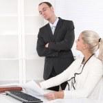 Bullying: boss controlling his secretary. — Stock Photo #36149953